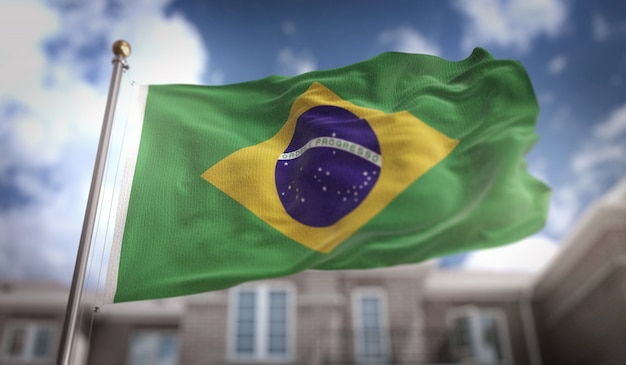 Brazil flag 3d rendering on blue sky building background