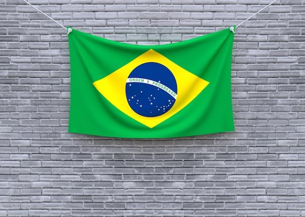 Brazil flag hanging on brick wall