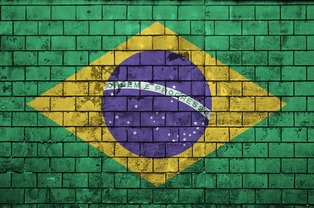 Brazil flag is painted onto an old brick wall