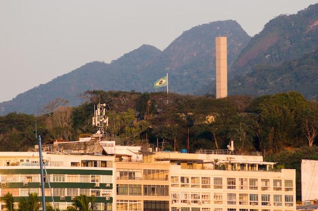 Brazil flag on top of pasmado hill in rio de janeiro brazil.