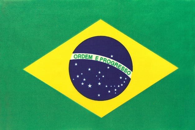 Brazil national fabric flag, textile background. symbol of international world america country.