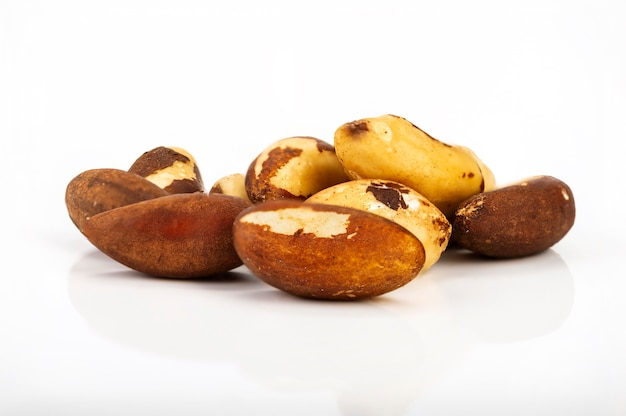 Brazil nut bertholletia excelsa on a white surface, isolated