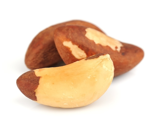 Brazil nuts isolated on white backgrounds closeup.