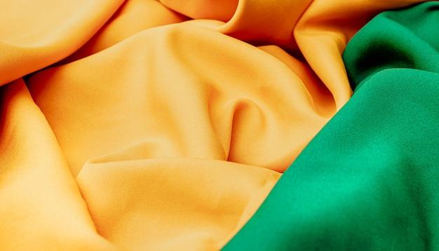 브라질 테마 질감 배경 녹색과 노란색 색상으로 패브릭 질감 배경