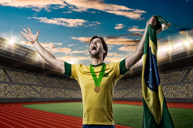 Brazilian athlete winning a golden medal on a track and field stadium.