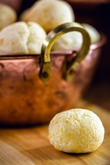 Brazilian cheese bread, typical food from the state of minas gerais, served in an old copper pot