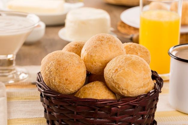 Brazilian cheese buns . table cafe in the morning with cheese bread and fruits.