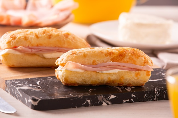 Brazilian cheese buns with cheese and ham . table coffee in the morning with cheese bread.