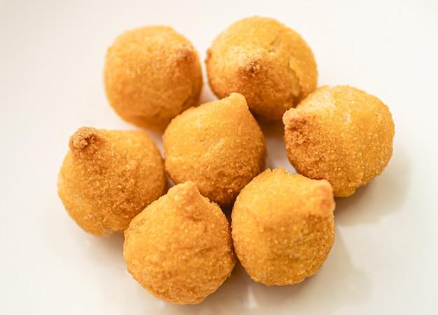 Brazilian chicken croquettes on a white plate