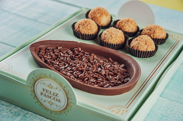 Brazilian chocolate easter egg in a gift box written happy easter with brazilian candy brigadeiro - ovo de chocolate de colher