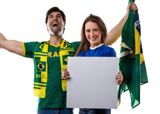 Brazilian couple holding white empty boards on a .