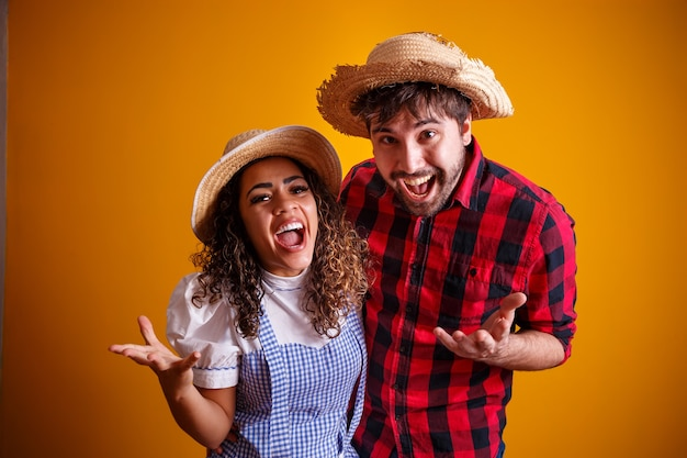 Brazilian couple wearing traditional clothes for festa junina