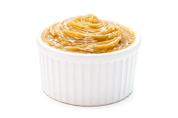 Brazilian dulce de leche, type of milk cream and pasty caramel, isolated white background