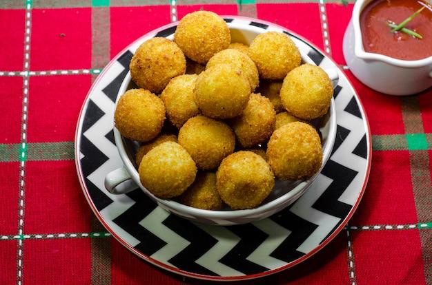 "Brazilian famous savory snack ""bolinha de queijo"" (fried cheese ball)"