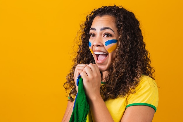 Brazilian fan with her face painted in blue and yellow for the brazil game. brazilian celebrating the independence of brazil. september 7th