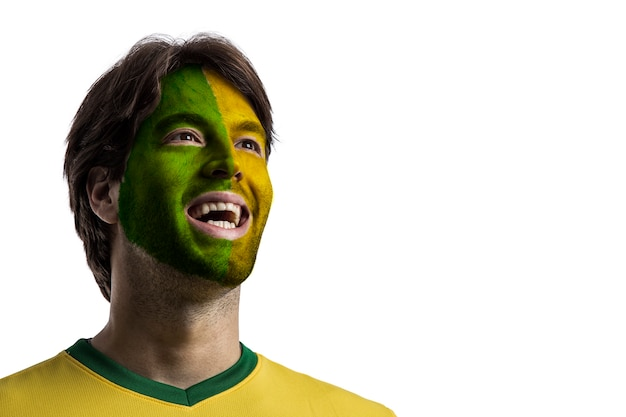 Brazilian fan with paint on his face celebrating