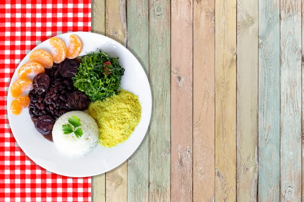 Brazilian feijoada. with a wooden background. top view - image