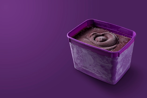 Brazilian frozen and acai berry ice cream purple bowl box. isolated on purple background. summer menu front view
