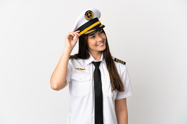 Brazilian girl airplane pilot over isolated white background thinking an idea