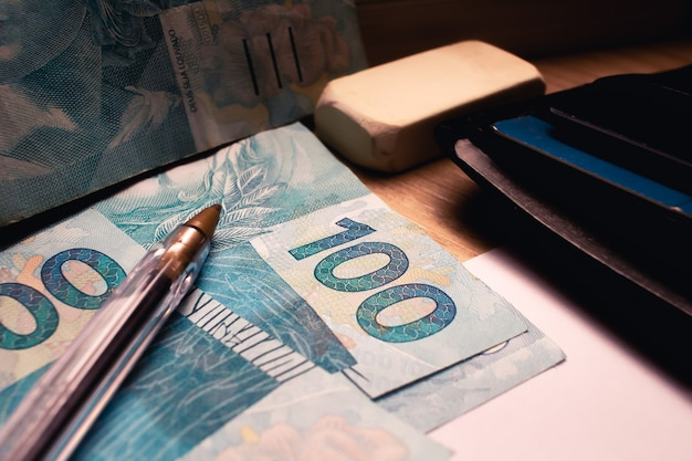 The brazilian money in close up photo for the concept of the brazilian economy
