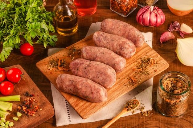 Сосиски бразильские из свинины с чимичурри на дровах со специями и ингредиентами
