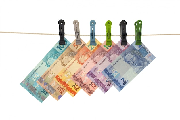 Brazilian real bank notes in a clothesline - money laundering - dirty money  concept - isolated