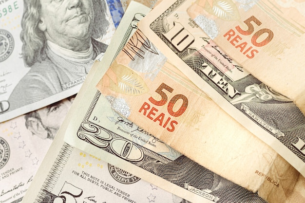 Brazilian real banknotes and us dollar banknotes for foreign exchange market concept