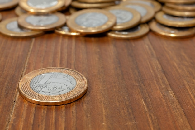 Brazilian real coin on a wood table