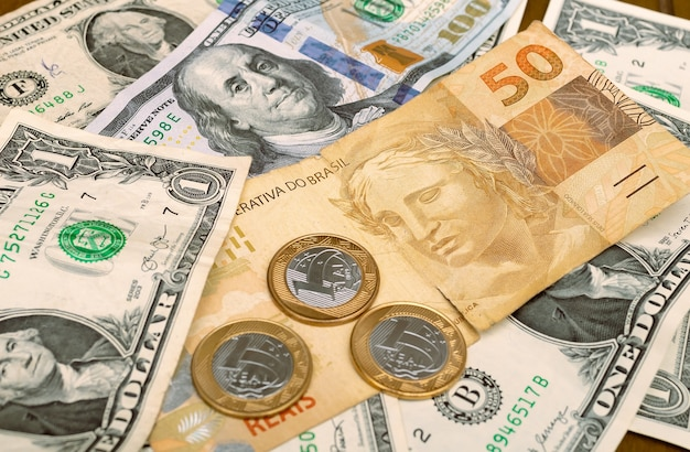 Brazilian real and us dollar in photo for foreign exchange market concept Premium Photo