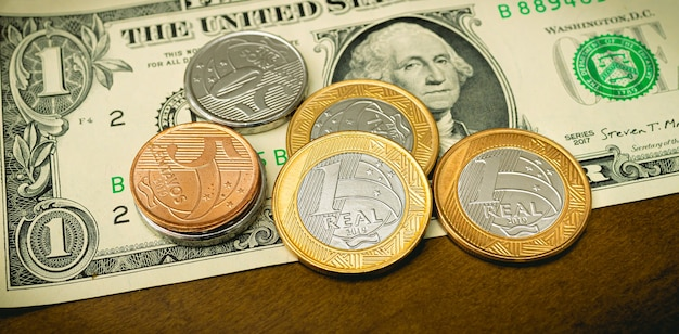 Brazilian real and us dollar in photo for foreign exchange market concept