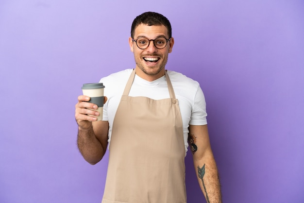 Brazilian restaurant waiter over isolated purple background with surprise facial expression