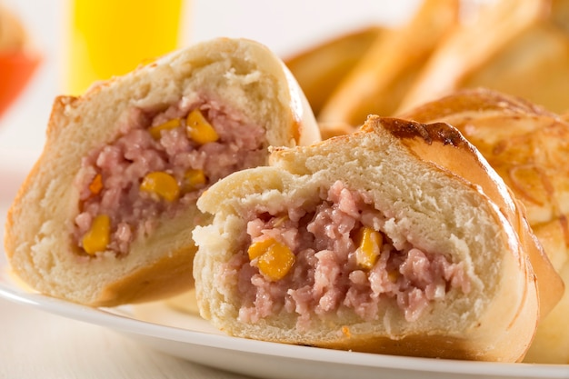Brazilian snack fried with cheese ham on wooden surface
