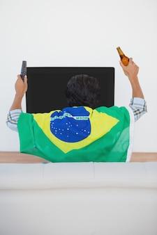 Brazilian soccer fan watching tv