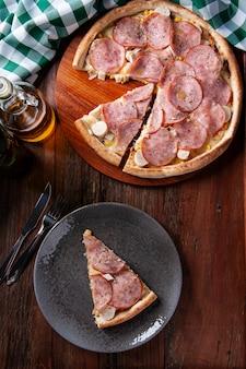 Brazilian-style sirloin pizza with mozzarella, hearts of palm and corn. top view. copy space