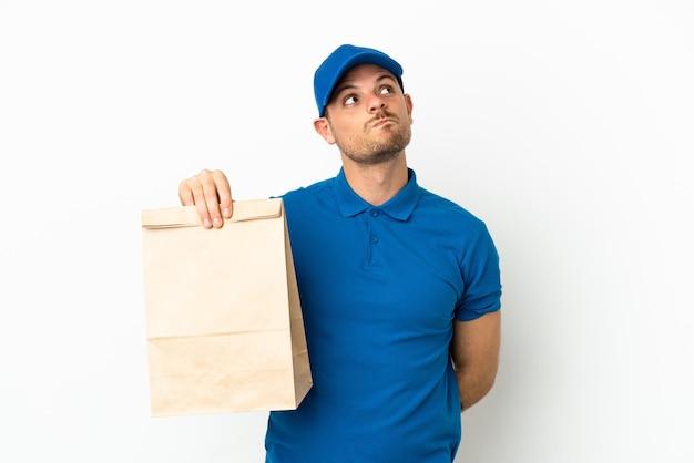 브라질 테이크 아웃 음식 가방을 흰색 배경에 고립 찾고 올려