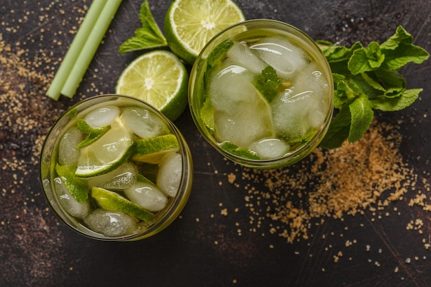 Brazilian traditional caipirinha with lime, sugar and mint. dark background, top view,  copy space.