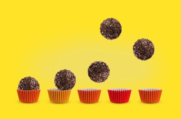 Brazilian traditional sweet called brigadeiro isolated on yellow surface