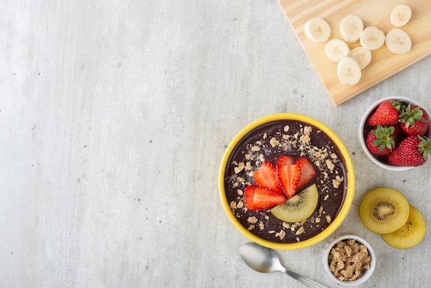 Brazilian typical acai bowl with fruits and muesli