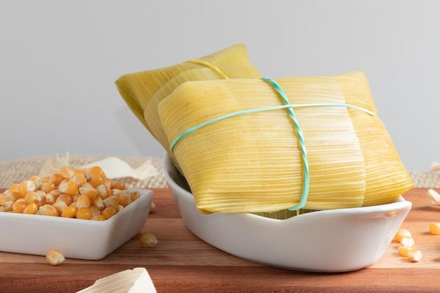 Brazilian typical snack made with corn, pamonha in a white bowl.