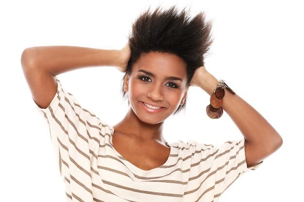 Brazilian woman posing with hands on head