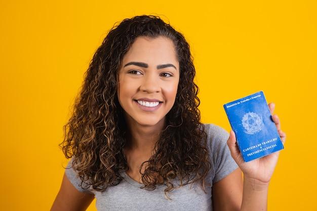 Brazilian woman with document work and social security, (carteira de trabalho e previdencia social)