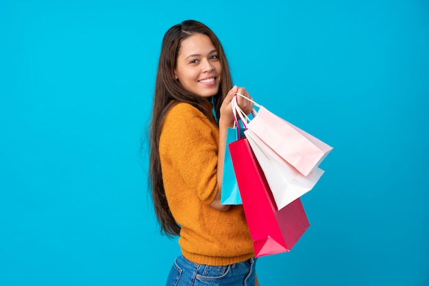 Brazilian woman with shopping bags