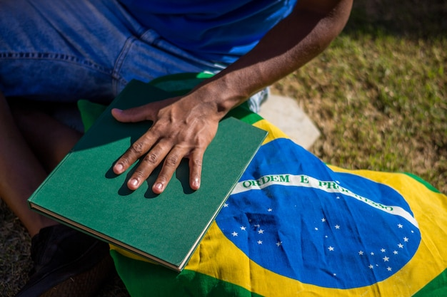 Brazilian young man student with brazil flag