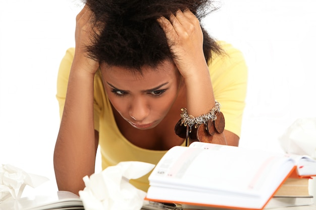 Brazilian young woman stressed with books