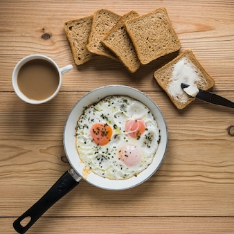 Bread and coffee near fried eggs