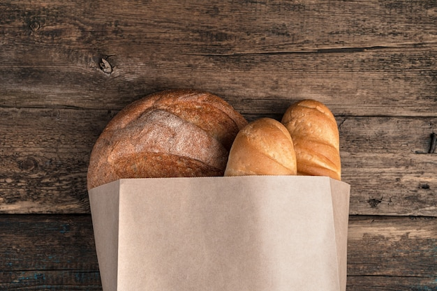 Bread in a bag on a wooden surface