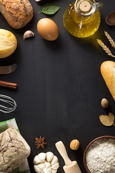 Bread and bakery ingredients on wooden