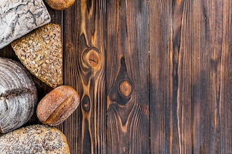 Bread border on dark wood with copy space background