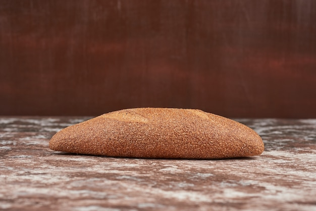 Bread bun on a marble background .