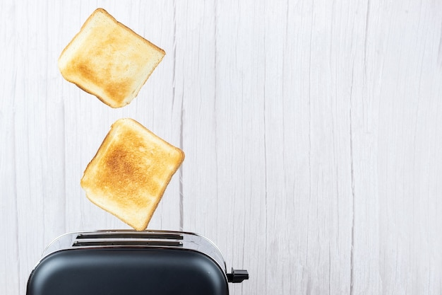 Bread coming out of the toaster